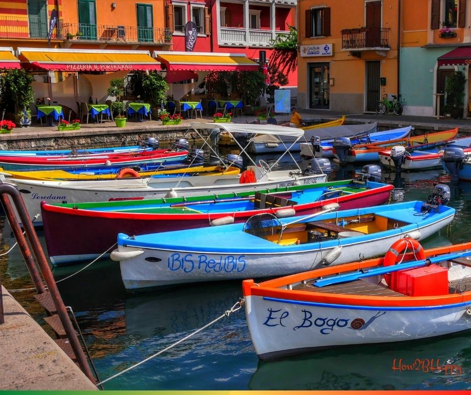 equal colorful boats at a European country