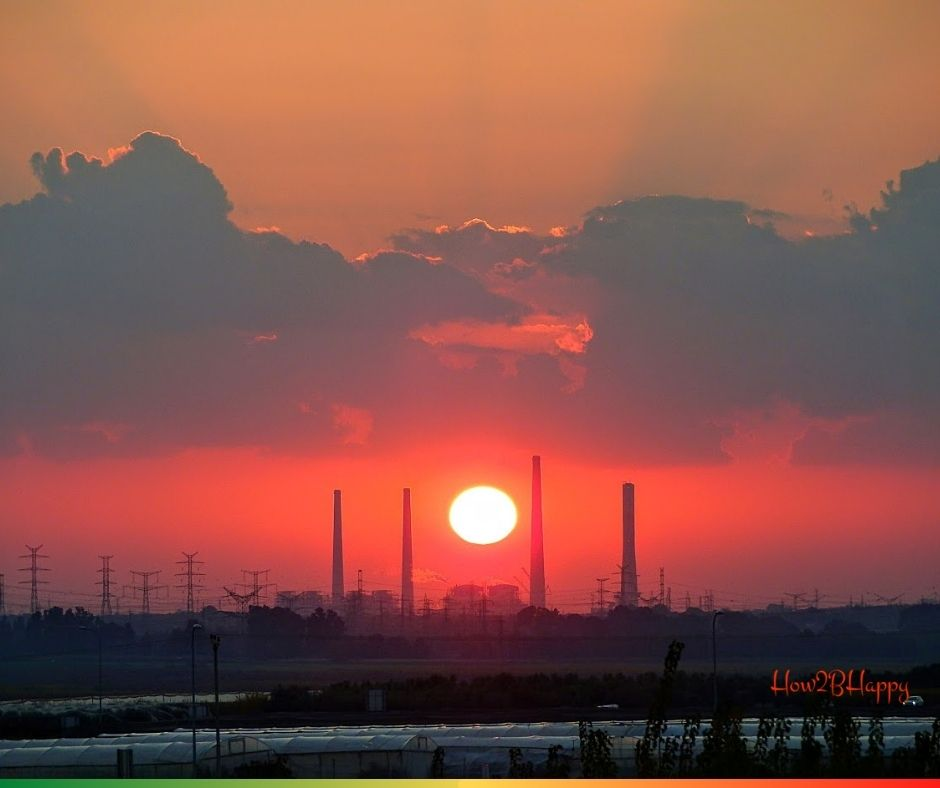 sun symbolizing money between pollution that works against the world